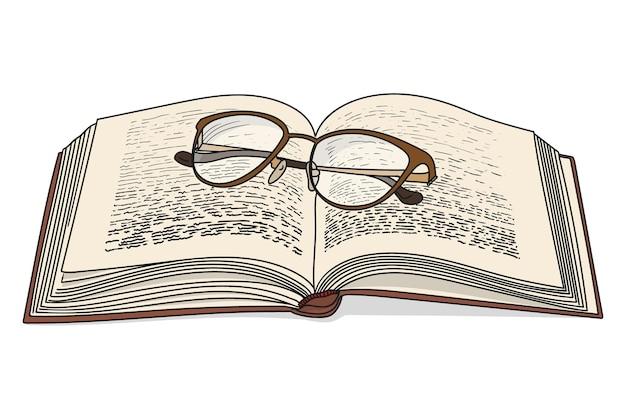 Un libro aperto con gli occhiali isolati su sfondo bianco.