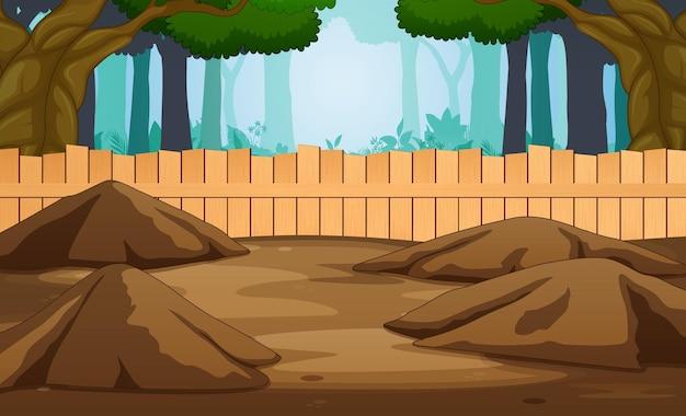 Gabbia aperta vicino all'illustrazione della foresta