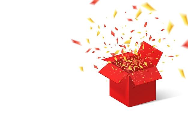 Apri confezione regalo rossa e coriandoli.