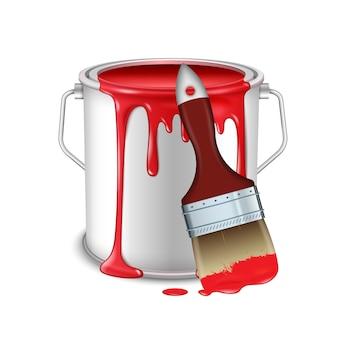 Una lattina aperta con vernice rossa rovesciata e un pennello imbrattato di vernice.
