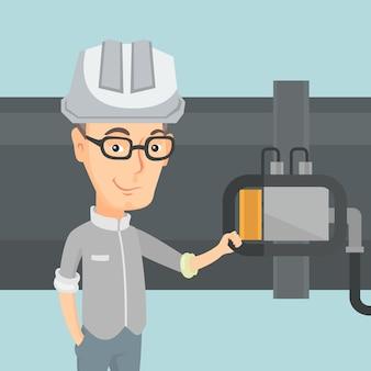 Operatore che controlla rivelatore sulla conduttura del gas.