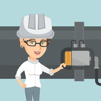 Operatore che controlla il rivelatore sulla conduttura.