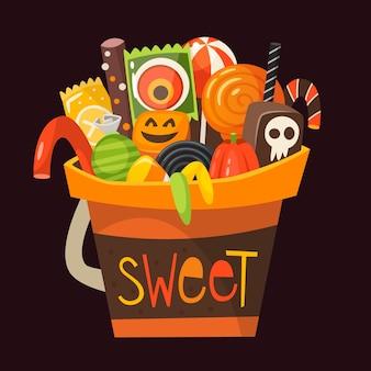 Secchio di halloween orang pieno di dolci, caramelle e dessert