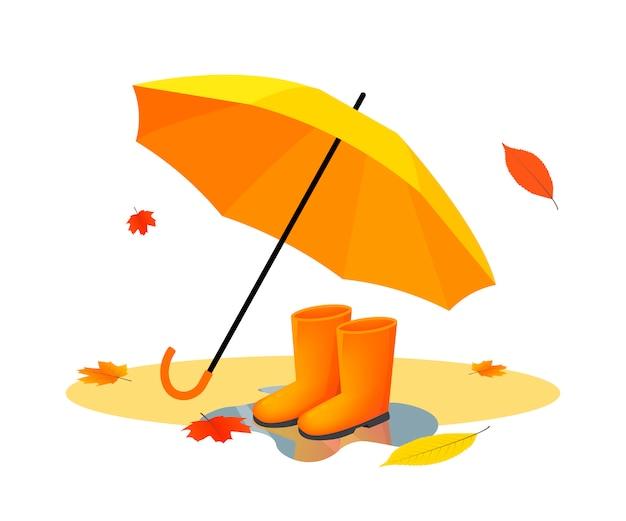 Ombrello arancione e stivali di gomma sulla pozzanghera dopo la pioggia con foglie di autunno