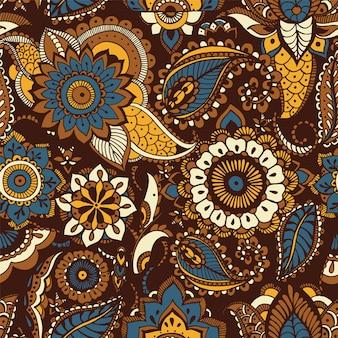 Modello senza cuciture orientale con motivi etnici buta ed elementi mehndi floreali persiani su sfondo marrone