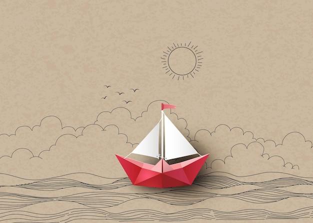 Barca a vela di carta fatta con origami. disegno a mano e taglio della carta.