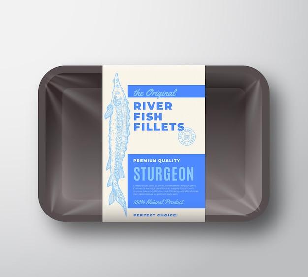 L'originale etichetta di disegno vettoriale astratto di filetti di pesce su vassoio di plastica con copertura in cellophane