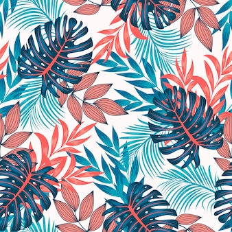 Modello tropicale senza cuciture originale con piante e foglie luminose su uno sfondo chiaro