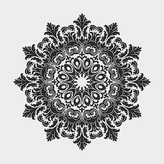Pizzo tondo ornamentale con elementi damascati ed arabeschi