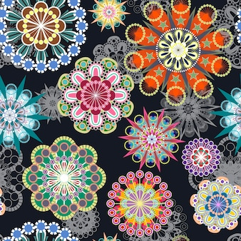 Ornato colorato motivo floreale senza soluzione di continuità su sfondo nero