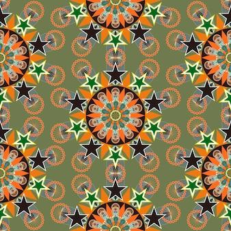 Ornato colorato motivo floreale senza soluzione di continuità su sfondo verde