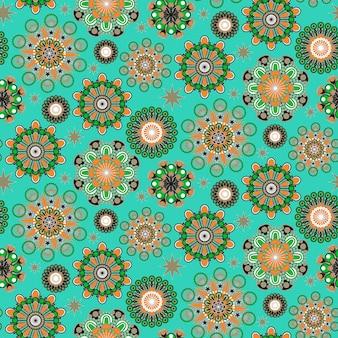 Ornato colorato motivo floreale senza soluzione di continuità su sfondo turchese