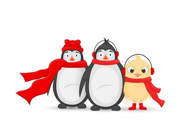 Gufo e pinguino con cappello e sciarpa di babbo natale