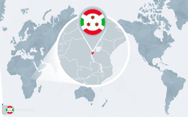 Mappa del mondo centrato sul pacifico con il burundi ingrandito. bandiera e mappa del burundi.