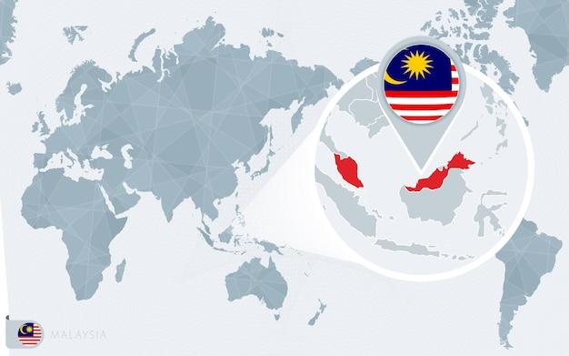 Mappa del mondo centrato sul pacifico con la malesia ingrandita. bandiera e mappa della malesia.