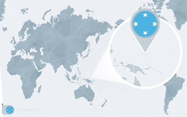 Mappa del mondo centrato sul pacifico con la micronesia ingrandita. bandiera e mappa della micronesia.