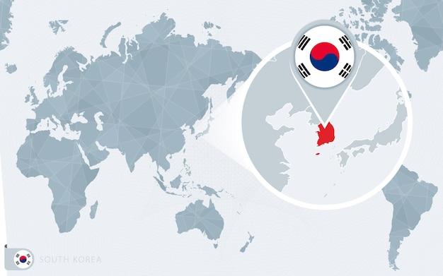Mappa del mondo centrato sul pacifico con la corea del sud ingrandita. bandiera e mappa della corea del sud.