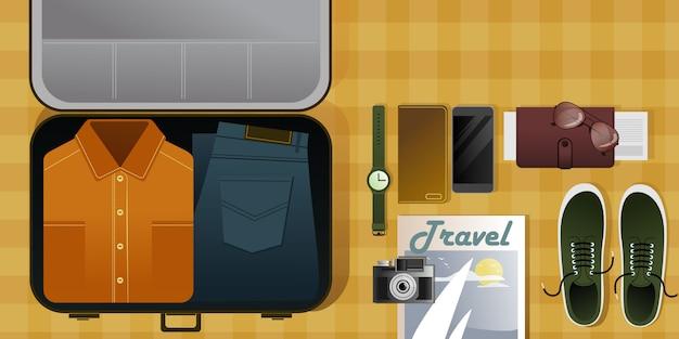 Fare le valigie in vacanza e raccogliere una borsa da uomo in viaggio. vista dall'alto.