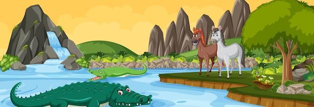 Scena del paesaggio panoramico con vari animali selvatici nella foresta