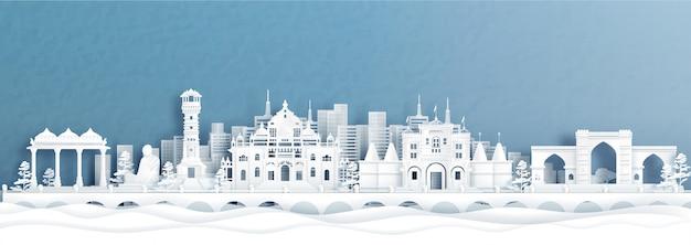 La vista panoramica dell'orizzonte di ahmedabad con i punti di riferimento famosi dell'india nello stile del taglio della carta.