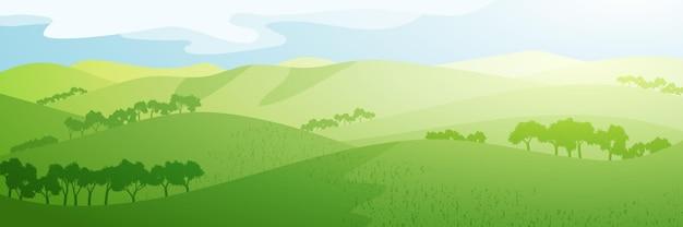 Vista panoramica di verdi colline in mattinata di sole