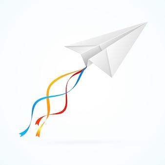 Aeroplano di carta bianco con nastri.