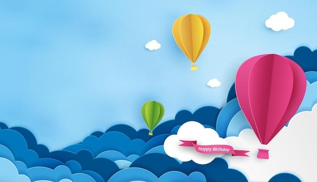 L'arte cartacea del compleanno con palloncino e nuvola nel cielo può essere utilizzata per l'invito alla carta da parati