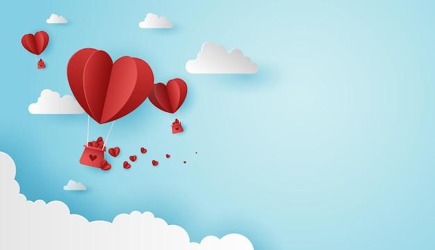 L'arte cartacea dell'amore e il giorno di san valentino con un palloncino a forma di cuore di carta e una confezione regalo galleggiano nel cielo blu