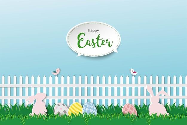 Stile di arte di carta con coniglio e uovo di pasqua sull'erba, per le vacanze di pasqua