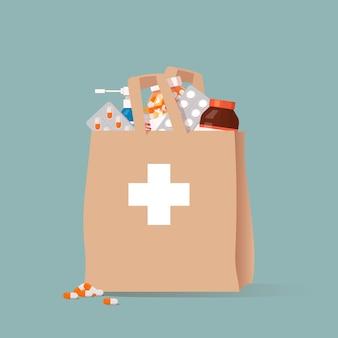 Sacchetto di carta con diversi farmaci.