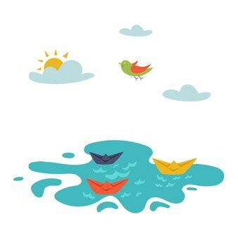 Barche di carta nell'acqua