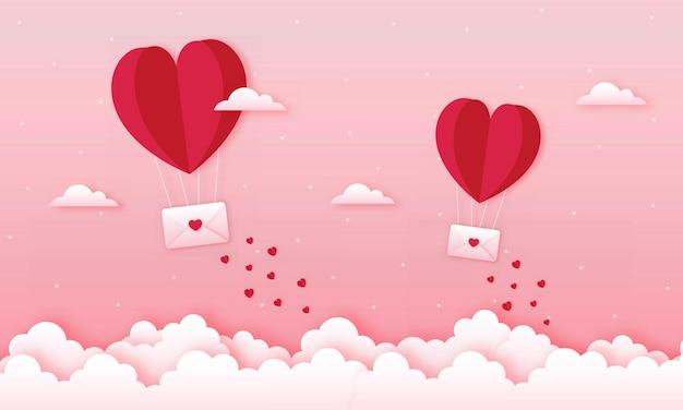 Carta tagliata felice concetto di san valentino. paesaggio con nuvole, mongolfiere a forma di cuore che volano e busta galleggiante