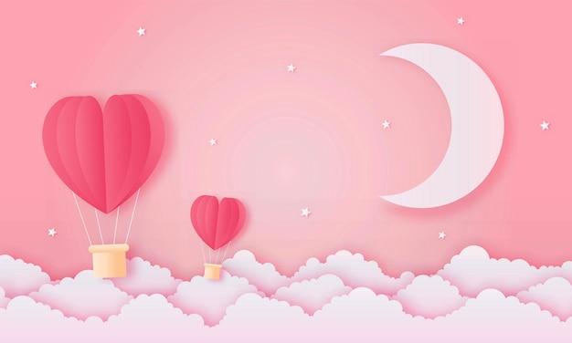 Carta tagliata felice concetto di san valentino. paesaggio con nuvole, luna e mongolfiere a forma di cuore che volano sul cielo rosa