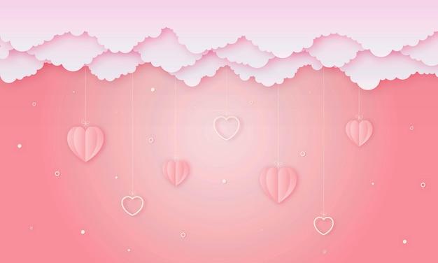 Carta tagliata amore e felice concetto di san valentino. origami a forma di nuvola e cuore