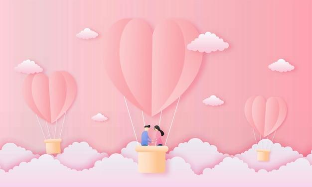 Carta tagliata amore e felice concetto di san valentino. coppia carina in mongolfiere a forma di cuore che volano sul cielo rosa