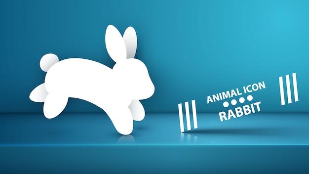 Icona di coniglio di carta sullo studio blu