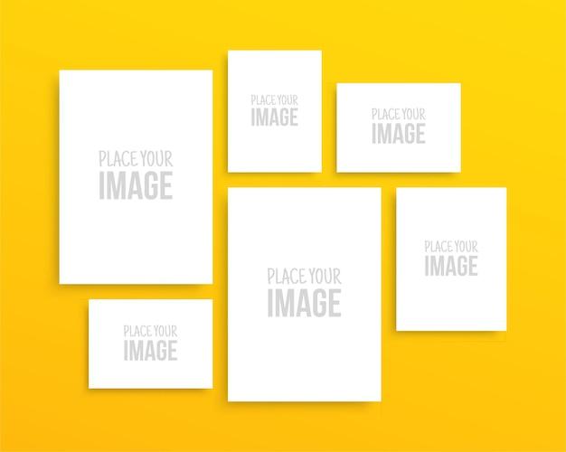 Raccolta di fogli di carta sulla parete gialla cornice per foto vuota galleria design isolato poster mockup