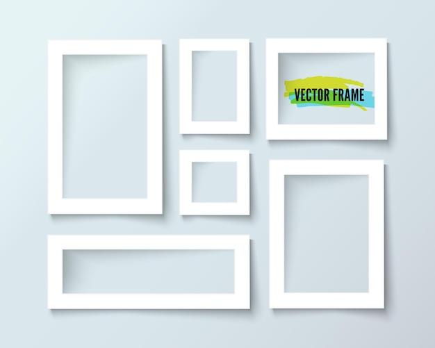 Composizione di cornici bianche di carta sul muro grigio, disegno vettoriale realistico