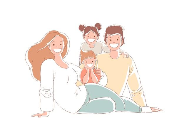 Genitori e figli sono seduti sul pavimento