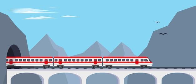 Treno espresso passeggeri sul ponte dal tunnel in montagna