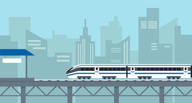 Treno passeggeri ad alta velocità sul ponte vicino alla stazione in città