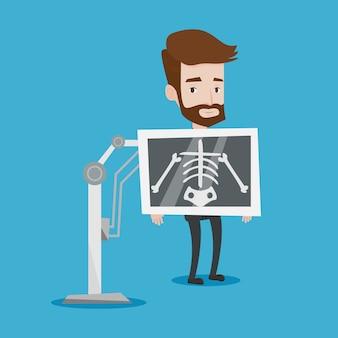 Paziente durante l'illustrazione della procedura dei raggi x