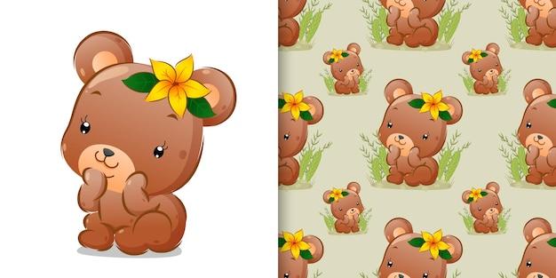 Il modello dell'orso seduto sull'erba con il fiore sulla sua testa di illustrazione