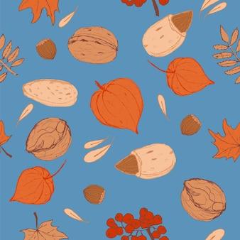 Modello di diversi dadi, foglie, ashberry e physalis