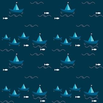 Motivo con navi di carta blu e mare con pesci