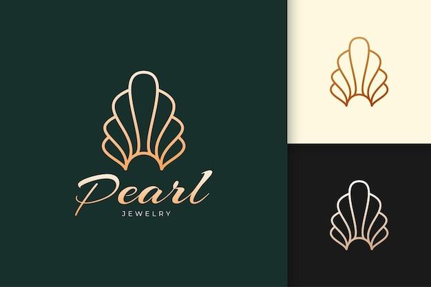 Logo di perle o gioielli di lusso e di classe a forma di conchiglia o vongola