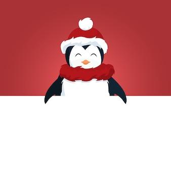Cartolina di natale del pinguino sopra il cartello bianco