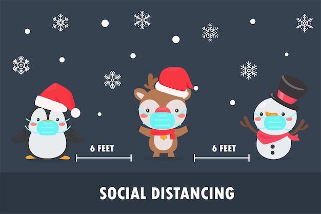 Pinguino, renne e pupazzi di neve indossano maschere e lasciano lo spazio sociale per evitare la corona durante il natale.