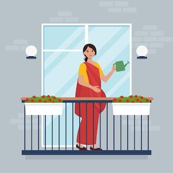 Persone sul balcone. resta a casa durante la pandemia. fiori d'innaffiatura della donna indiana. illustrazione piatta