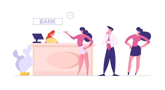 Persone in banca stand alla scrivania dell'operatore in attesa del turno per effettuare operazioni finanziarie
